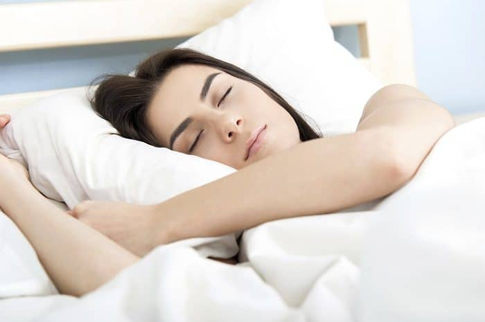 Attractive young woman sleeping in bed.